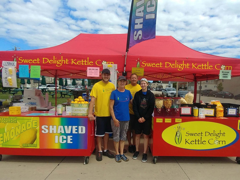 A photo of Sweet Delights Kettle Corn booth.